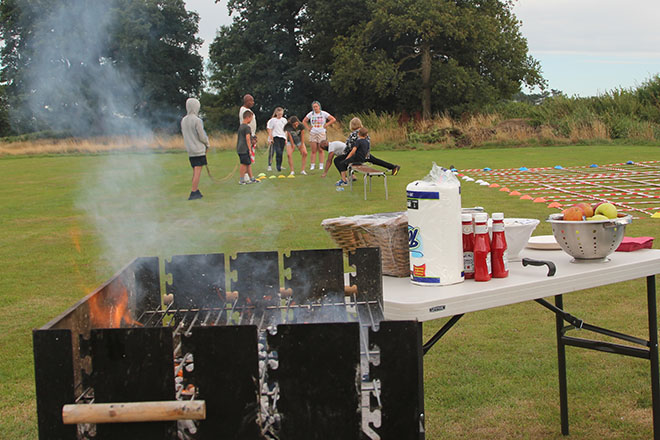 Pupils Having a Barbecue During Fisher Youth Club Summer Camp