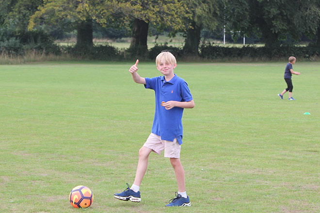 Pupils Playing Football at Fisher Youth Club Summer Camp