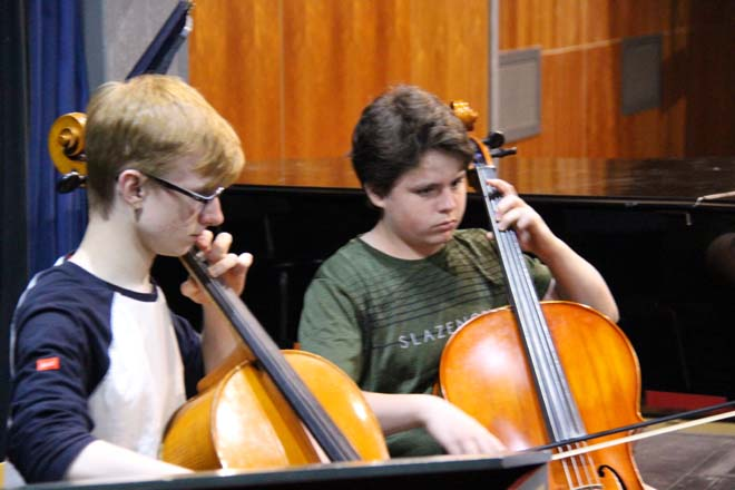 Boys playing cellos
