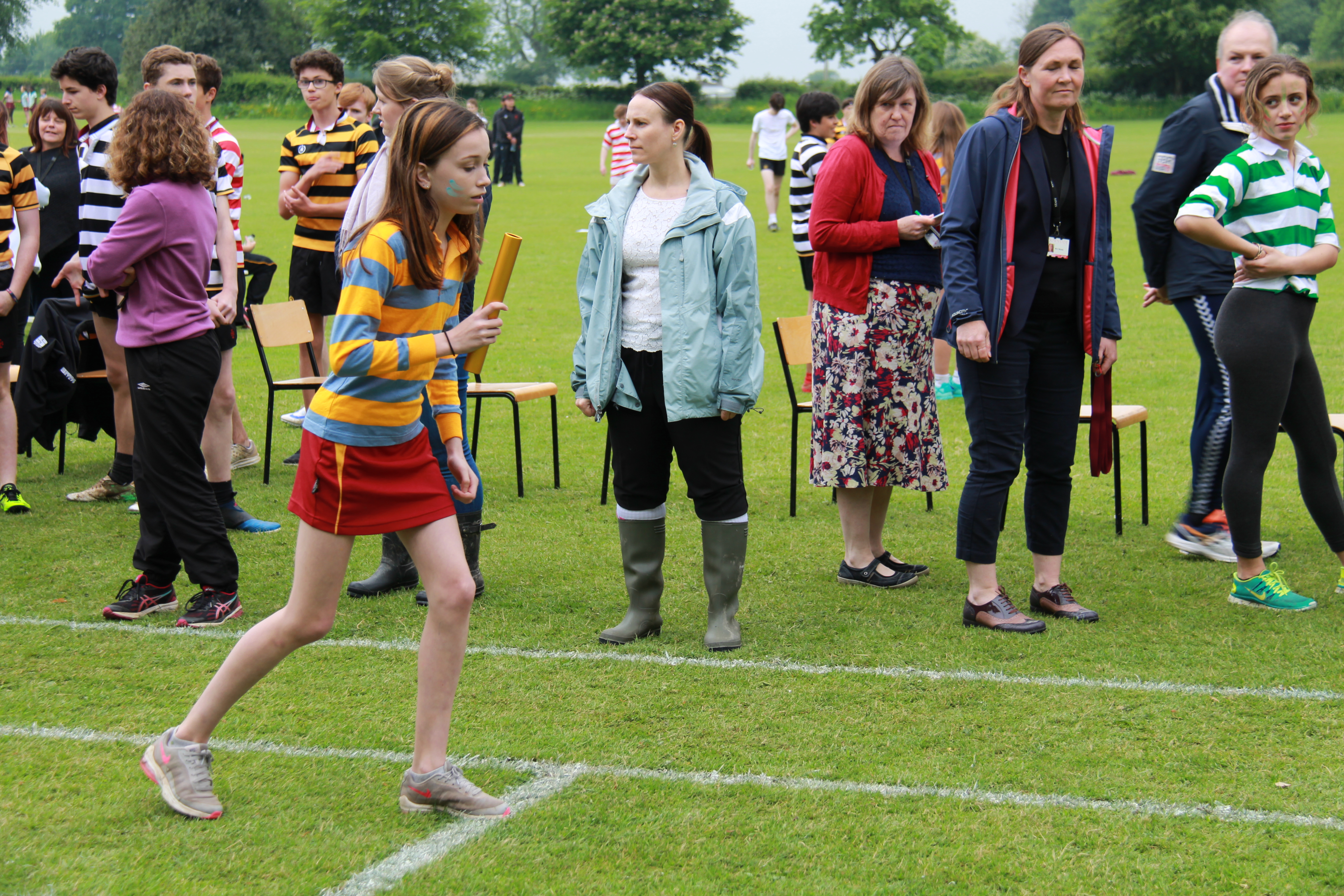 Girl running relay at sports day 2018