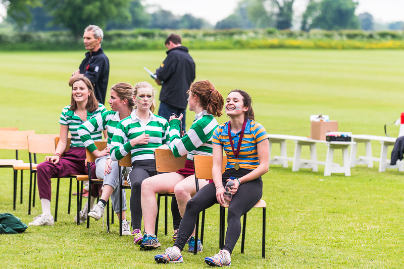Girls sat down talking at sports day 2018