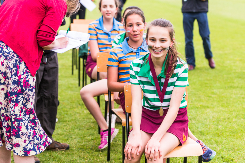 Girls sitting at sports day 2018