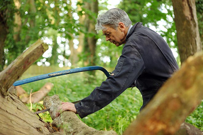 Father Michael sawing wood at Downside Abbey
