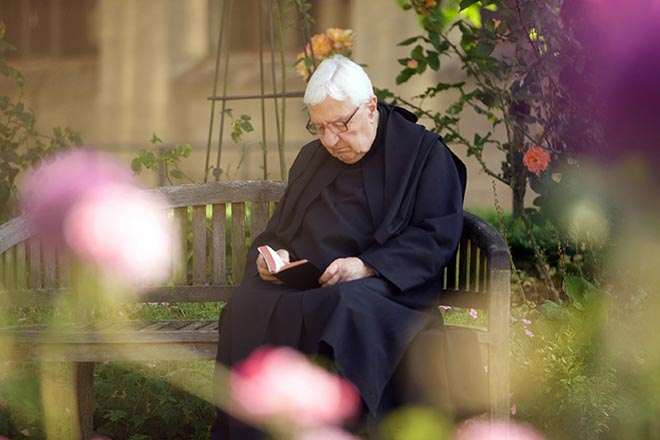 Father Christopher reading in the garden at Downside Abbey