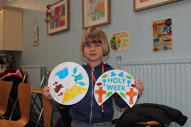 Easter at Downside Abbey - Pupil Holding Drawings for Holy Week